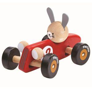 Stor röd bil med kanin